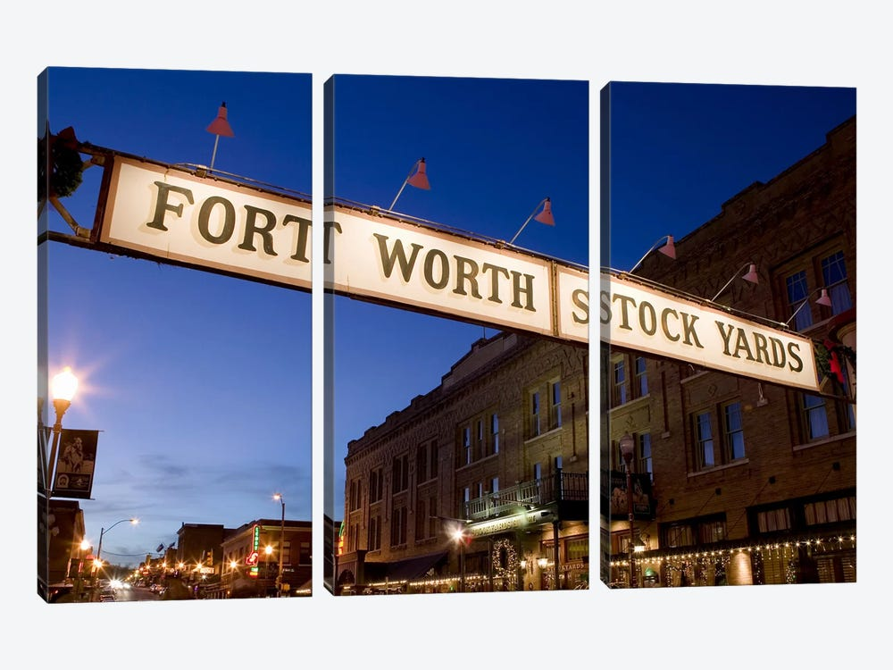 Signboard over a road at dusk, Fort Worth Stockyards, Fort Worth, Texas, USA by Panoramic Images 3-piece Canvas Wall Art