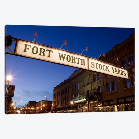 Signboard over a road at dusk, Fort Worth Stockyards, Fort Worth, Texas, USA Canvas Print #PIM8860} by Panoramic Images Art Print
