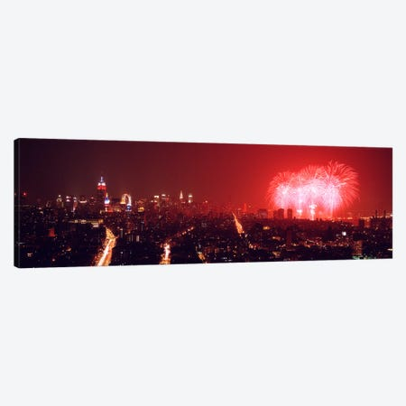 Fireworks display at night over a city, New York City, New York State, USA Canvas Print #PIM9002} by Panoramic Images Canvas Art
