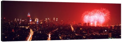 Fireworks display at night over a city, New York City, New York State, USA Canvas Art Print