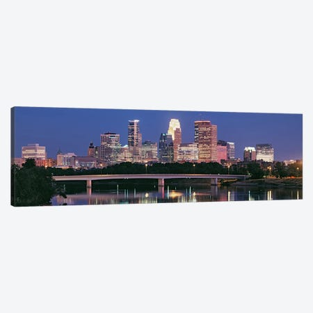 Buildings lit up at night in a city, Minneapolis, Mississippi River, Hennepin County, Minnesota, USA Canvas Print #PIM9015} by Panoramic Images Canvas Wall Art