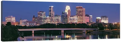 Buildings lit up at night in a city, Minneapolis, Mississippi River, Hennepin County, Minnesota, USA Canvas Art Print