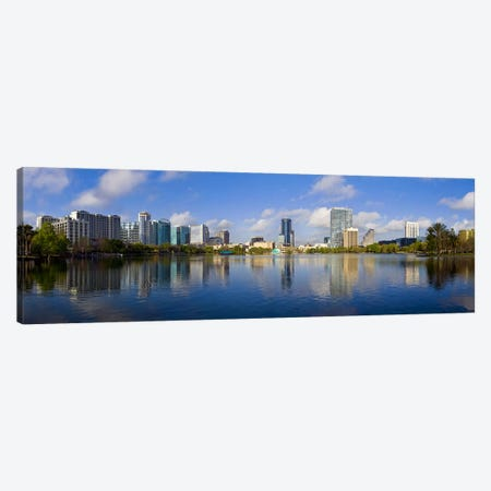 Reflection of buildings in a lake, Lake Eola, Orlando, Orange County, Florida, USA 2010 Canvas Print #PIM9020} by Panoramic Images Canvas Artwork
