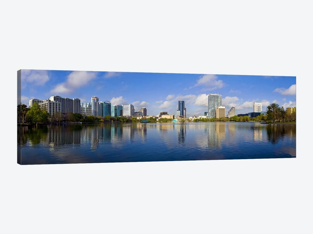 Reflection of buildings in a lake, Lake Eola, Orlando, Orange County, Florida, USA 2010 by Panoramic Images 1-piece Canvas Art Print