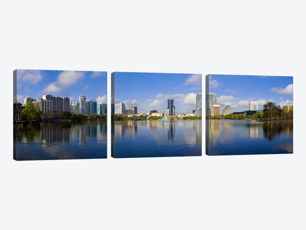 Reflection of buildings in a lake, Lake Eola, Orlando, Orange County, Florida, USA 2010 by Panoramic Images 3-piece Canvas Print