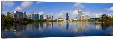 Reflection of buildings in a lake, Lake Eola, Orlando, Orange County, Florida, USA 2010 Canvas Art Print