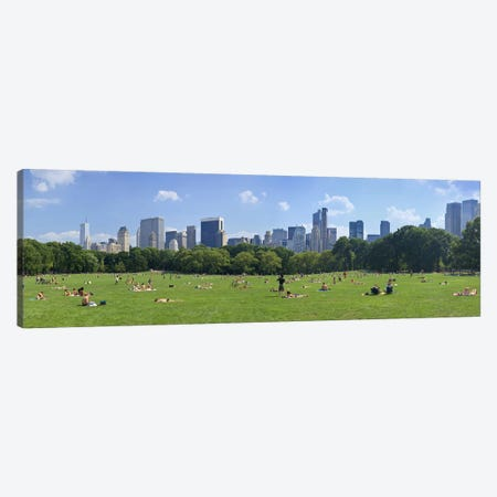 Tourists resting in a parkSheep Meadow, Central Park, Manhattan, New York City, New York State, USA Canvas Print #PIM9021} by Panoramic Images Canvas Artwork