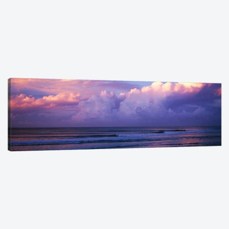 Clouds over the sea at sunset Canvas Print #PIM9043} by Panoramic Images Canvas Wall Art
