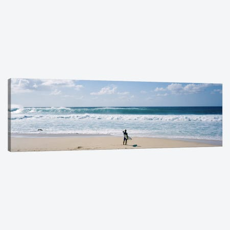 Surfer standing on the beachNorth Shore, Oahu, Hawaii, USA Canvas Print #PIM9054} by Panoramic Images Canvas Artwork