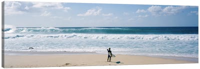 Surfer standing on the beachNorth Shore, Oahu, Hawaii, USA Canvas Print #PIM9054