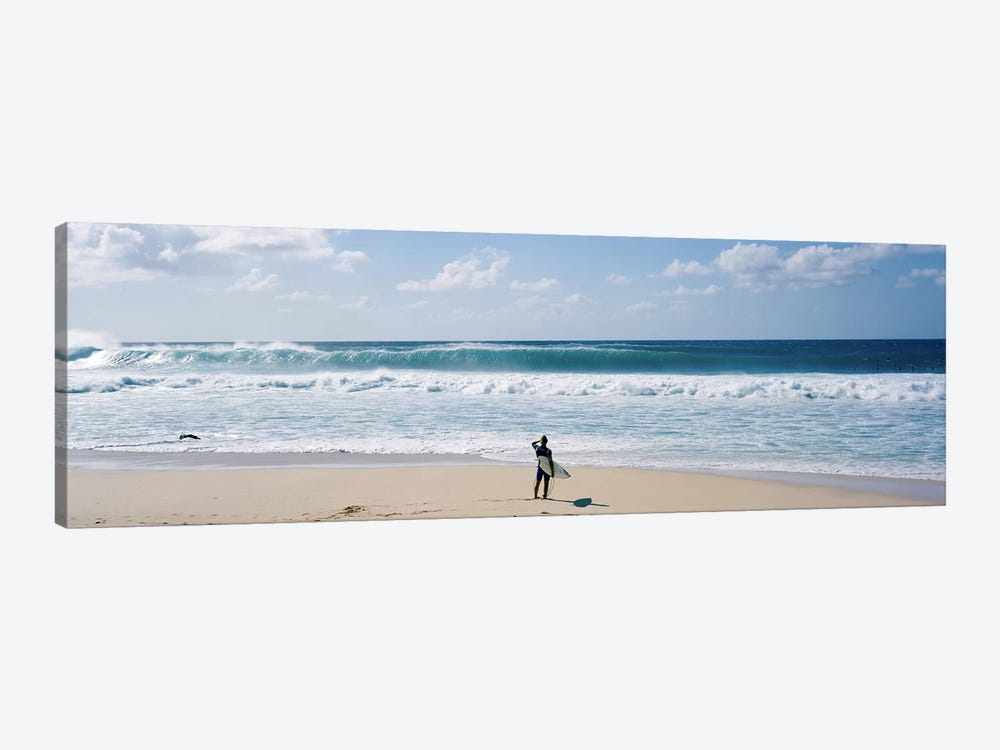 Surfer standing on the beachNorth Shore, Oahu, Hawaii, USA by Panoramic Images 1-piece Canvas Artwork