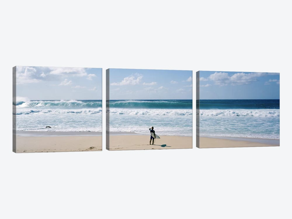 Surfer standing on the beachNorth Shore, Oahu, Hawaii, USA by Panoramic Images 3-piece Canvas Art