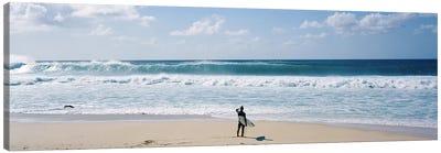 Surfer standing on the beachNorth Shore, Oahu, Hawaii, USA Canvas Art Print
