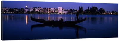 Boat in a lake with city in the background, Lake Merritt, Oakland, Alameda County, California, USA Canvas Print #PIM9164