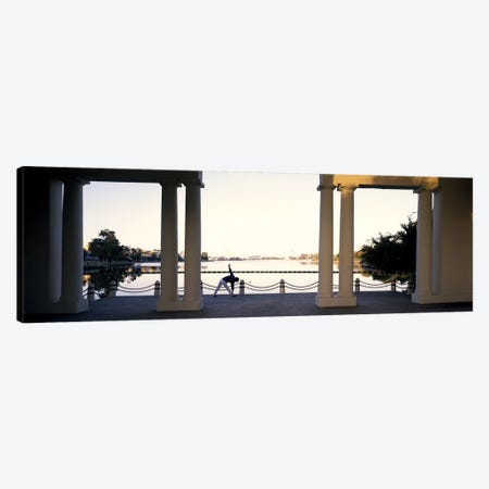 Person stretching near colonnade, Lake Merritt, Oakland, Alameda County, California, USA Canvas Print #PIM9166} by Panoramic Images Canvas Art