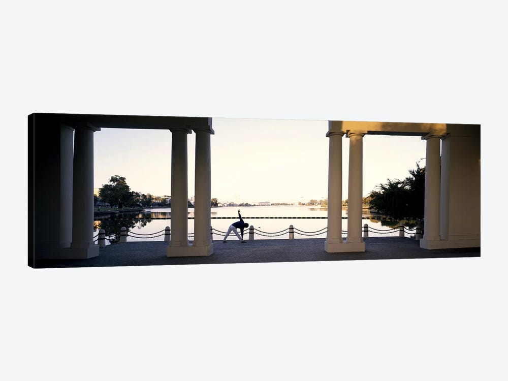 Person stretching near colonnade, Lake Merritt, Oakland, Alameda County, California, USA by Panoramic Images 1-piece Canvas Wall Art