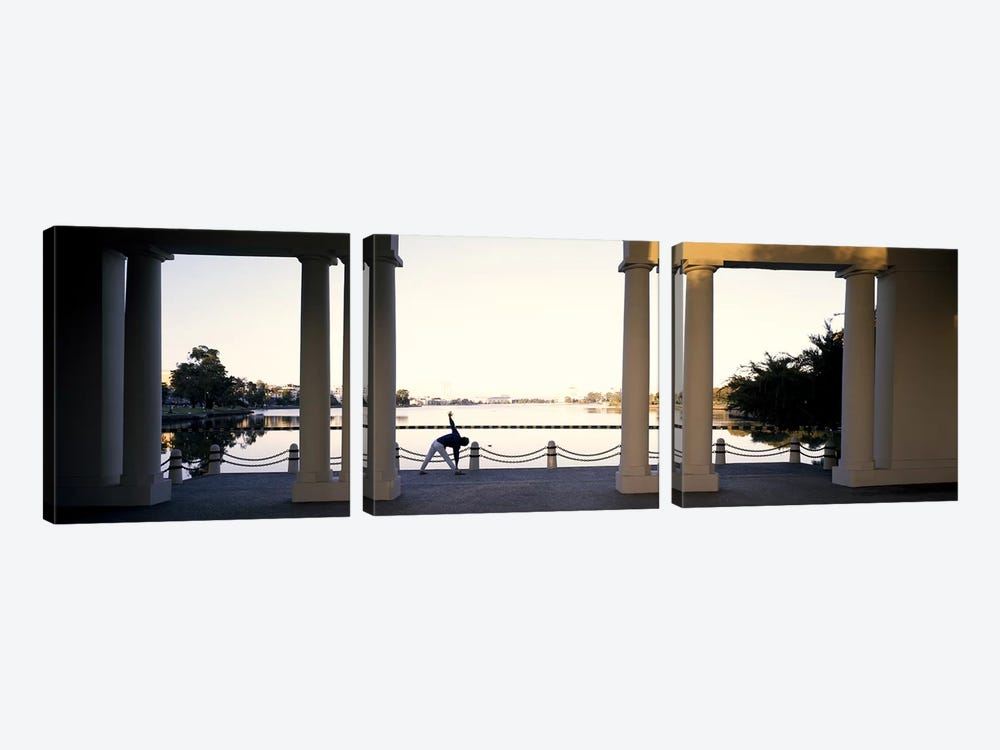 Person stretching near colonnade, Lake Merritt, Oakland, Alameda County, California, USA by Panoramic Images 3-piece Canvas Artwork
