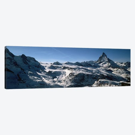 Skiers on mountains in winter, Matterhorn, Switzerland Canvas Print #PIM9210} by Panoramic Images Canvas Art Print