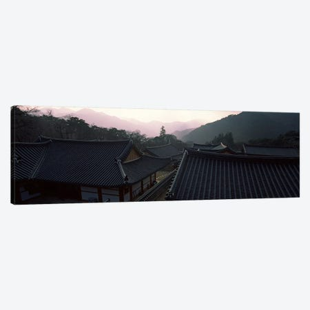Buddhist temple with mountain range in the background, Kayasan Mountains, Haeinsa Temple, Gyeongsang Province, South Korea Canvas Print #PIM9245} by Panoramic Images Art Print