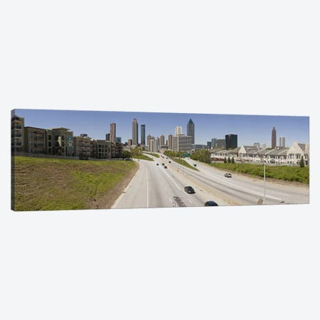 Vehicles moving on the road leading towards the city, Atlanta, Georgia, USA Canvas Print #PIM9253} by Panoramic Images Canvas Art Print