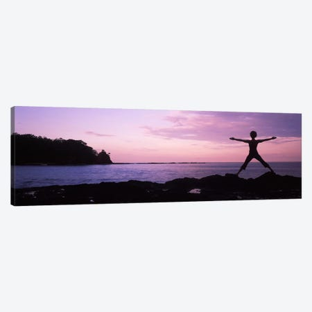 Rear view of a woman exercising on the coast, La Punta, Papagayo Peninsula, Costa Rica Canvas Print #PIM9256} by Panoramic Images Canvas Artwork