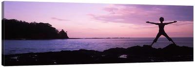 Rear view of a woman exercising on the coast, La Punta, Papagayo Peninsula, Costa Rica Canvas Print #PIM9256