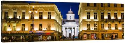 Buildings in a city lit up at night, Nevskiy Prospekt, St. Petersburg, Russia Canvas Art Print