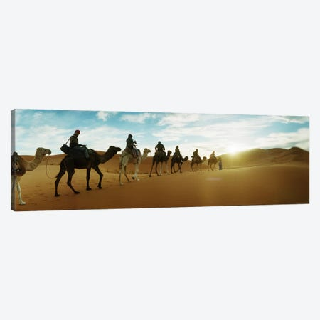 Tourists riding camels through the Sahara Desert landscape led by a Berber man, Morocco #2 Canvas Print #PIM9590} by Panoramic Images Canvas Artwork