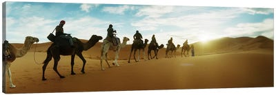Tourists riding camels through the Sahara Desert landscape led by a Berber man, Morocco #2 Canvas Art Print