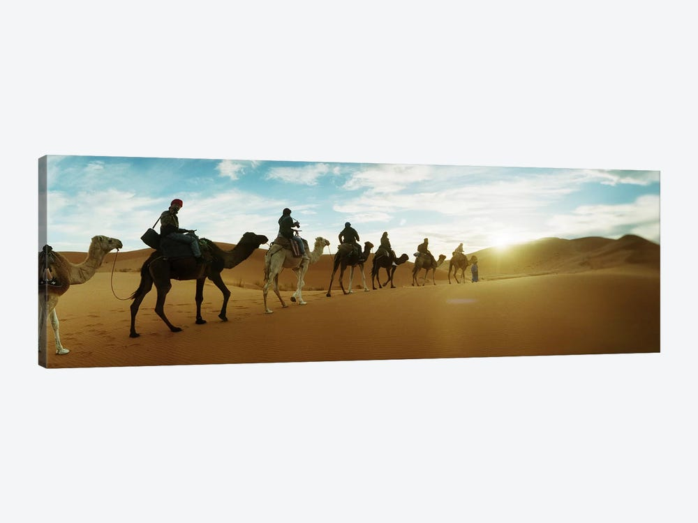 Tourists riding camels through the Sahara Desert landscape led by a Berber man, Morocco #2 1-piece Canvas Art