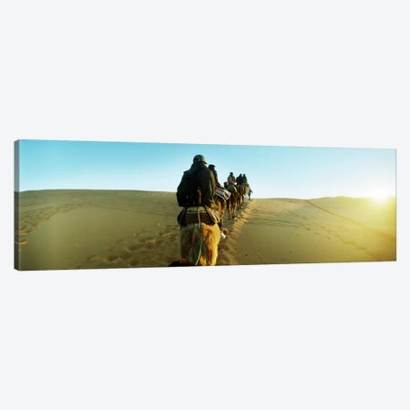 Row of people riding camels through the desert, Sahara Desert, Morocco Canvas Print #PIM9591} by Panoramic Images Canvas Art