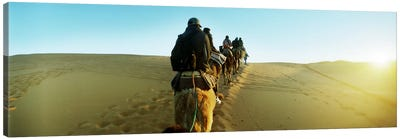 Row of people riding camels through the desert, Sahara Desert, Morocco Canvas Art Print