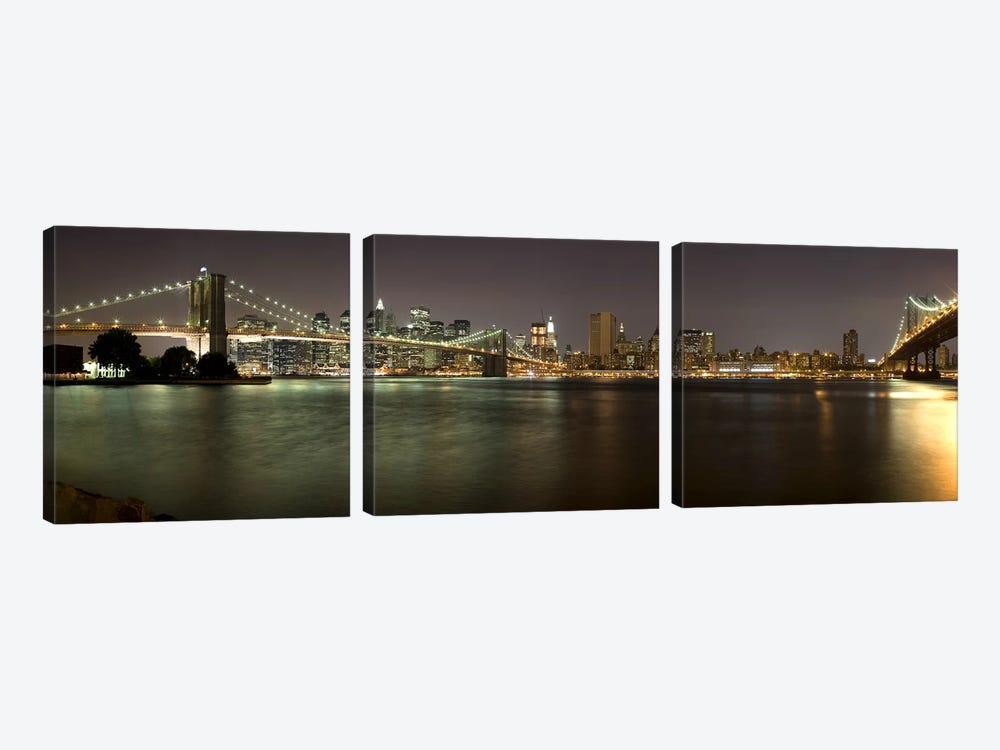 Brooklyn Bridge and Manhattan Bridge across East River at night, Manhattan, New York City, New York State, USA by Panoramic Images 3-piece Canvas Print