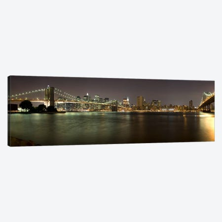 Brooklyn Bridge and Manhattan Bridge across East River at night, Manhattan, New York City, New York State, USA Canvas Print #PIM9727} by Panoramic Images Canvas Artwork