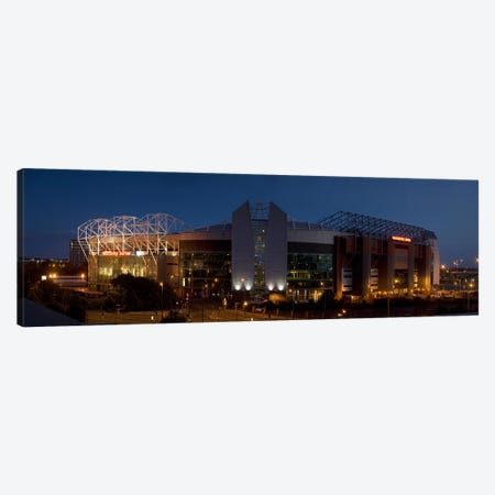 Football stadium lit up at night, Old Trafford, Greater Manchester, England Canvas Print #PIM9732} by Panoramic Images Canvas Artwork