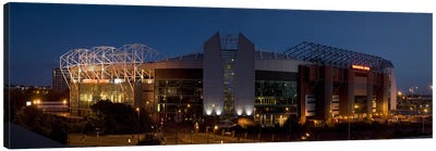 Football stadium lit up at night, Old Trafford, Greater Manchester, England Canvas Art Print