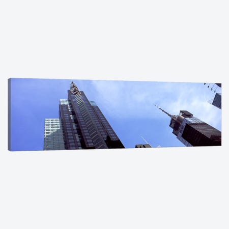 Low angle view of skyscrapers in a city, New York City, New York State, USA 2011 Canvas Print #PIM9755} by Panoramic Images Canvas Art Print