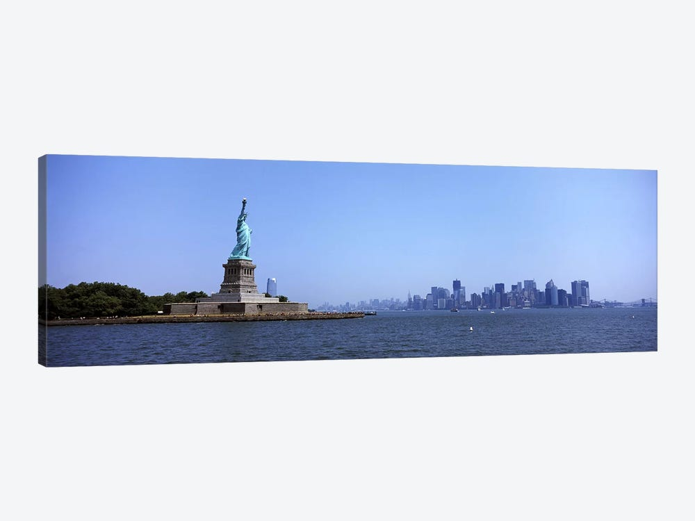 Statue Of Liberty with Manhattan skyline in the background, Liberty Island, New York City, New York State, USA 2011 by Panoramic Images 1-piece Art Print