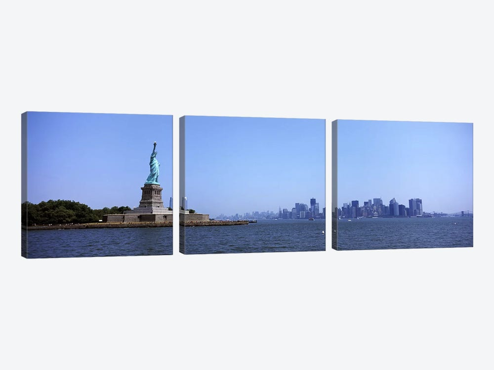Statue Of Liberty with Manhattan skyline in the background, Liberty Island, New York City, New York State, USA 2011 by Panoramic Images 3-piece Canvas Art Print