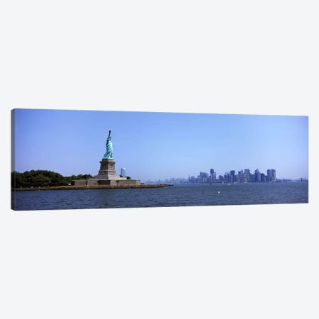 Statue Of Liberty with Manhattan skyline in the background, Liberty Island, New York City, New York State, USA 2011 Canvas Print #PIM9758} by Panoramic Images Canvas Art