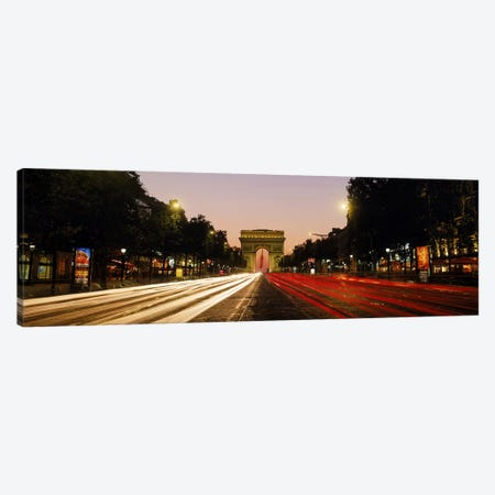 Blurred Motion View Of Nighttime Traffic On Avenue des Champs-Elysees Looking Toward Arc de Triomphe, Paris, France Canvas Print #PIM9771} by Panoramic Images Canvas Wall Art