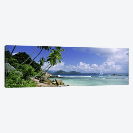 Coastal Landscape With A Distant View Of Praslin Island From Anse Severe Beach, La Digue, Seychelles Canvas Print #PIM9775} by Panoramic Images Canvas Art Print