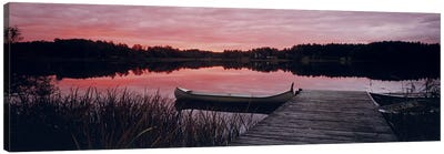 Canoe tied to dock on a small lake at sunset, Sweden Canvas Print #PIM9782