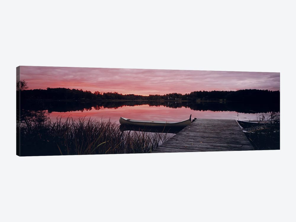 Canoe tied to dock on a small lake at sunset, Sweden by Panoramic Images 1-piece Canvas Wall Art