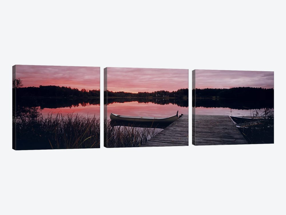 Canoe tied to dock on a small lake at sunset, Sweden by Panoramic Images 3-piece Canvas Artwork