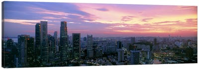 High angle view of a city at sunset, Singapore City, Singapore Canvas Art Print