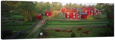 Traditional red farm houses and barns at village, Stensjoby, Smaland, Sweden Canvas Art Print