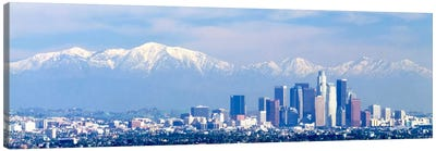 Buildings in a city with snowcapped mountains in the background, San Gabriel Mountains, City of Los Angeles, California, USA Canvas Art Print