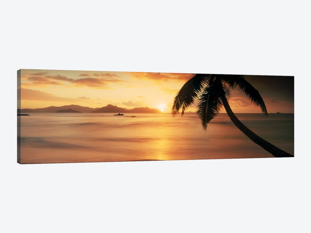 Silhouette of a palm tree on the beach at sunsetAnse Severe, La Digue Island, Seychelles 1-piece Canvas Artwork
