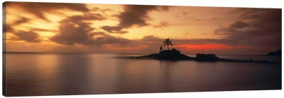 Silhouette of a palm tree on an island at sunsetAnse Severe, La Digue Island, Seychelles Canvas Art Print